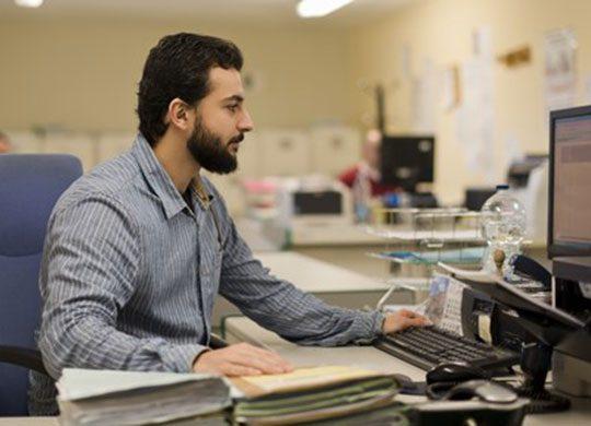 Photo of employee working on computer