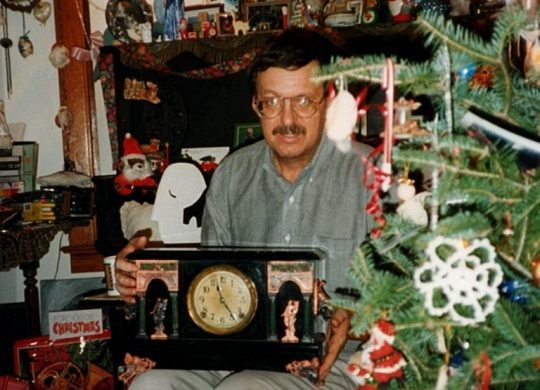 Photo of man with clock
